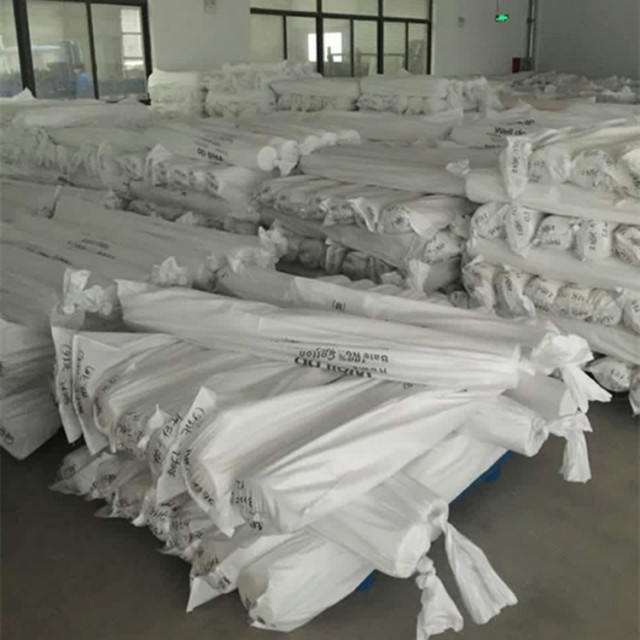 China textile 100% cotton fabric stock lot woven bag outer packaging